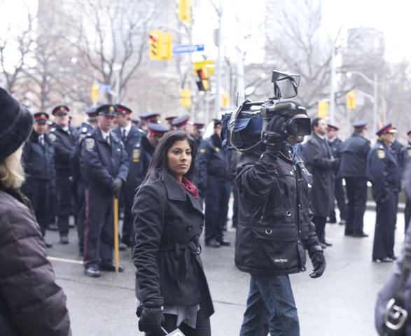 Journos wander Sgt. Russell's funeral. Photo by Dana Lacey.